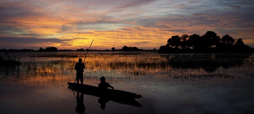 Okavango Delta Mokoro Sunset by Dana Allen