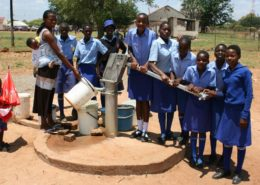 School girls collect water